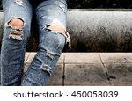 fashion women's legs in jeans   Shutterstock . vector #450058039