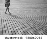 Woman Walking In City Street....