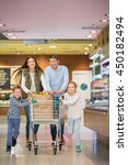 smiling family with shopping...   Shutterstock . vector #450182494