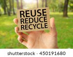 hand holding a brown recycled... | Shutterstock . vector #450191680