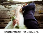 a view from below on a hugging... | Shutterstock . vector #450207376