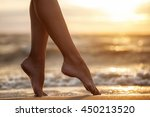 sexy woman's legs  on the sandy ... | Shutterstock . vector #450213520