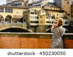 girl photographs an old bridge... | Shutterstock . vector #450230050