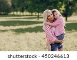 mom and daughter walk in the... | Shutterstock . vector #450246613