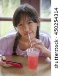 happy asian girl drinking ice... | Shutterstock . vector #450254314