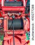 Small photo of sling wire rope drum crane offshore oil and gas field on remote wellhead platform.