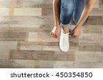 woman hands tying sport shoes   Shutterstock . vector #450354850