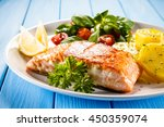 fried salmon and vegetables  | Shutterstock . vector #450359074