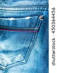 blue jeans on wooden background | Shutterstock . vector #450364456