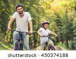 handsome young dad and his cute ... | Shutterstock . vector #450374188