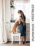 Kid Girl Feeding Ginger Cat At...