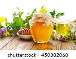 full honey pot and honey stick... | Shutterstock . vector #450382060