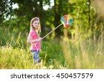 cute little girl catching... | Shutterstock . vector #450457579