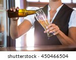 Waitress Preparing A Beer In A...
