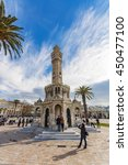 Small photo of Izmir, Turkey - January 21, 2011 : People are visiting Clock Tower in the Konak Square. Clock Tower is populer tourist attraction in Izmir.