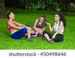 three cheerful sportswomen...   Shutterstock . vector #450498646