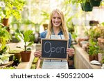 portrait of young woman holding ... | Shutterstock . vector #450522004