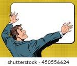 Retro Man Unfolds A Poster Pop...