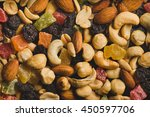 nuts and dried fruits... | Shutterstock . vector #450597706