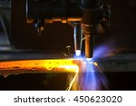 Small photo of Metal cutting with acetylene torch close-up on low ligth