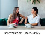 two happy women talking in cafe.... | Shutterstock . vector #450663499
