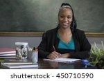 black female teacher grading... | Shutterstock . vector #450710590