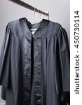 Black Graduation Gowns Hanging...
