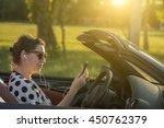 woman listen music in car | Shutterstock . vector #450762379