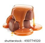 caramel sauce pouring on... | Shutterstock . vector #450774520