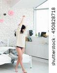 Small photo of Woman Brunette Step Tiptoe Morning Pullover Barefoot Awakening Bedroom Concept