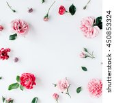 Stock photo round frame wreath pattern with roses pink flower buds branches and leaves isolated on white 450853324