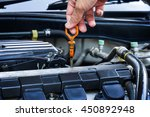 check the oil level in car... | Shutterstock . vector #450892948