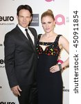 Small photo of Hollywood, California; March 2, 2014; Steven Moyer and Anna Pacquin arrive to Elton John AIDS Foundation Presents 22nd Academy Awards Viewing Party.