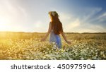beautiful girl in daisy field.... | Shutterstock . vector #450975904