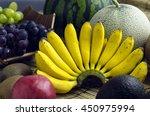 fruit placed on a bamboo mat | Shutterstock . vector #450975994