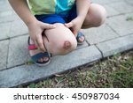 Small photo of child hurt his knee on the pavement. abrasion