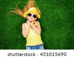 joyful little girl in colorful... | Shutterstock . vector #451015690