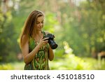 Woman With A Camera On Nature