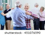 group of seniors enjoying... | Shutterstock . vector #451076590