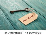 Small photo of real estate rent concept - old key with tag
