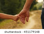 the parent holds the hand of a...   Shutterstock . vector #451179148