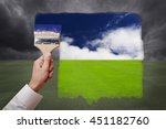 man hand holding painting brush ... | Shutterstock . vector #451182760