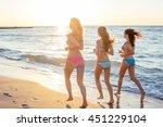 three girls having fun on beach ... | Shutterstock . vector #451229104