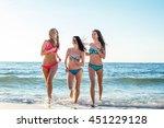 three girls having fun on beach ... | Shutterstock . vector #451229128