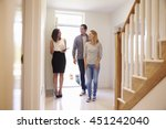 realtor showing young couple... | Shutterstock . vector #451242040