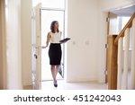 female realtor in hallway... | Shutterstock . vector #451242043