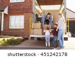 family unpacking moving in... | Shutterstock . vector #451242178
