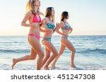three girls having fun on beach ... | Shutterstock . vector #451247308