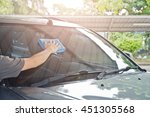 cleaning the car glass  | Shutterstock . vector #451305568