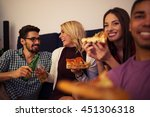 friends eating pizza at home... | Shutterstock . vector #451306318